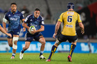 Blues 1st5 Dan Bowden looks to step Brumbies flanker Scott Fardy during the Blues and Brumbies Super Rugby match at Eden Park, Auckland. 10 April 2015. Photo / Jason Oxenham.