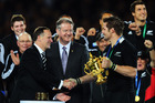 John Key's unusual three-way handshake was one of the more uncomfortable moments of the 2011 Rugby World Cup. Photo / Getty Images