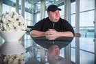 Kim Dotcom in his penthouse apartment before a judge ruled he is eligible for extradition to the US