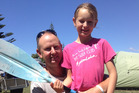 Jim Davenport and his daughter Carly Davenport, 9, after their kayak capsized in Bay of Plenty after which they had a close encounter with either a pilot whale or orca - they are still unsure.