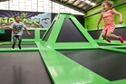 Thayo Gapes, 7, (right) and Kingdym Pitman, 6, enjoy a bounce at Flip Out Rotorua, which opens to the public today. Photo / Stephen Parker