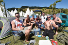 Aucklanders Cameron Knudsen, Evan Plester, Andy Rutherford, Isaac Kerr, Jared Tomblinson, Josh Lankford, Don Gray, Lincoln Lam set up camp. Photo / Paul Rickard, Gisborne Herald