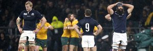 Greig Laidlaw, middle, looks dejected while Australian players celebrate the victory. Photo / Getty