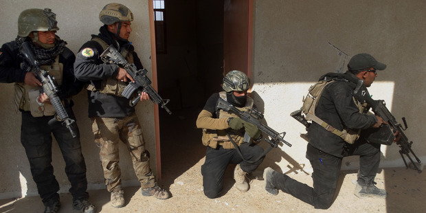 Iraqi security forces search a building in the government complex in central Ramadi. Photo / AP
