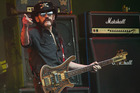 Motorhead bassist Lemmy Kilmister performing on the Pyramid stage during Glastonbury Music Festival. Photo / AP