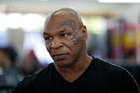 Former boxer Mike Tyson met his match when playing with a popular Christmas gift. Photo / AP