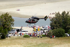 The Lowe Corporation Rescue Helicopter comes into  Ocean Beach  after  3-year-old Jimmy Atilua Laulu drowned in the lagoon.