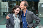 Nicky Hager celebrates with his daughter Julia Wells outside the High Court in Wellington after winning his case against police that his home was searched illegally. Photo / Martin Hunter