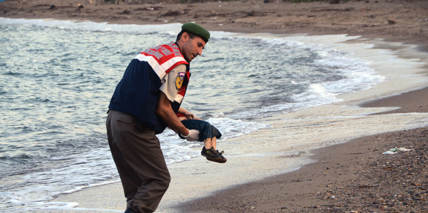 A heart-wrenching photograph of a three-year-old boy washed up on a Turkish beach.