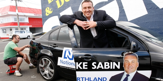 HAPPIER DAYS: Signwriter Matt Redfern putting the finishing touches to Mike Sabin's car as the former Kaitaia detective prepares to launch his 2011 election campaign.