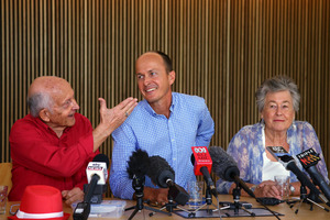 Juris, left, and Lois Greste, parents of Australian journalist Peter Greste, and his brother Andrew, center, speak to the media at a press conference in Brisbane. Photo / AP