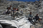 Mountaineers with the wreckage of the plane that crashed in the Andes in 1961, killing 24 people. Photo / AP