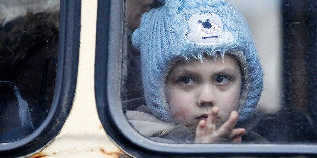A child waits on a bus to leave Debaltseve, Ukraine, where a separatist offensive is aiming to claw territory from Kiev. Photo / AP