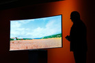 Joe Stinziano, executive vice president of Samsung Electronics America, introduces a Samsung SUHD 4K TV at a news conference in January. Photo / AP