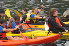 Students try out kayaks at Hillary Outdoors.