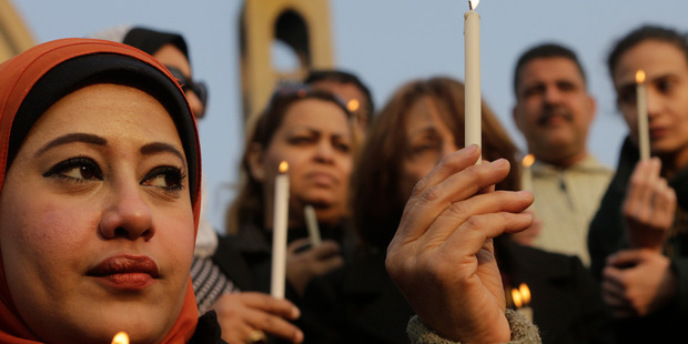 Egyptians light candles during a vigil for Christians who were killed in Libya, at St. Mark's Cathedral in Cairo, Egypt. Photo / AP