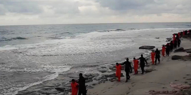 Isis militants walk 21 Egyptian Coptic Christians to their deaths in Libya.