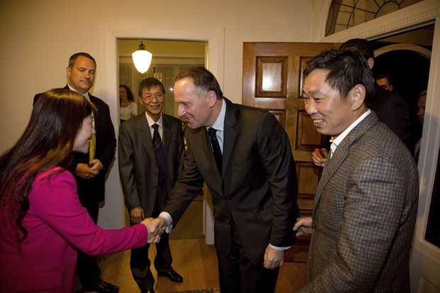Mr Liu's wife, Juan Zhang, greets John Key.