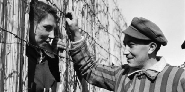 A prisoner chatting with a prostitute at the Nazi camp of Dachau in May 1945. AFP Photo / Eric Schwab