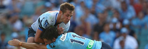Kyle Godwin of the Force is tackled by Rob Horne of the Waratahs. Photo / Getty Images