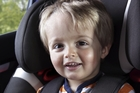Children should be in car seats until they're over the recommended weight. Photo / Getty Images