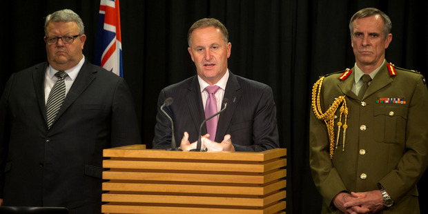 Loading Defence Minister Gerry Brownlee, Prime Minister John Key and Defence Force Chief Lieutenant General Tim Keating during their media conference. Photo / Mark Mitchell