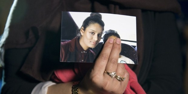A photo of British girl Shamima Begum, who is thought to have fled to Syria to join Isis, is held up by her eldest sister Renu. Photo / AFP