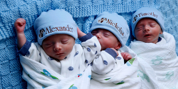 Identical triplets Alexander, Nicholas and Timothy Whiteley. Photo / AP