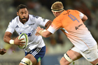 Patrick Tuipulotu of the Blues attempts to avoid the tackle of Carl Wegner of the Cheetahs. Photo / Getty Images