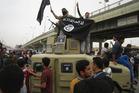 Islamic State group militants in Fallujah. File photo / AP