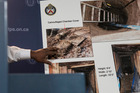 Toronto's Deputy Police Chief Mark Saunders gestures as he explains evidence photos to the media about the tunnel. Photo / AP