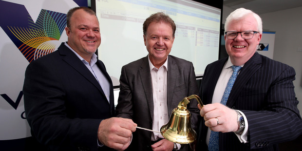 Vista chief executive Murray Holdaway (centre) with chairman Kirk Senior (left) and NZX chief Tim Bennett at last year's first day as an NZX-listed company. Photo / NZ Herald
