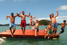 The first leap: Swimmers take the plunge from Paihia's new swimming pontoon, called Motu Iti (Little Island). PHOTO / Russell Carlyon