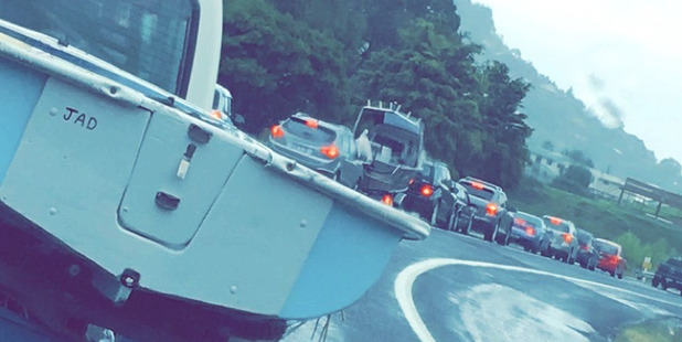 Traffic builds up as people leave the Coromandel for Auckland early due to bad weather. Photo / Rhonda Matthews