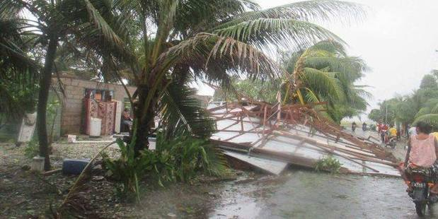 Cyclone Ula has caused property damage, ripping roofs off houses and destroying plant crops. Photo / Facebook