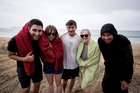 UK visitors Shaun Jeffers, Alice Fellows, Nick Mills and Olivia Bloom revel in the wet while holidaying at Waitete Bay with local Brent Purcell. Photo / Dean Purcell