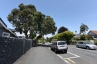 THREATENED TREE: The axe hovers over this landmark pohutukawa in Devonport Rd.PHOTO/GEORGE NOVAK