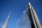 The Address Downtown Hotel is surrounded by smoke early on January 1. Photo / Getty Images