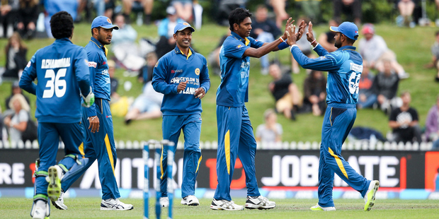 Dushmantha Chameera, second right, celebrates with his Sri Lankan team mates after Kane Williamson is sent packing. Photo / Getty Images