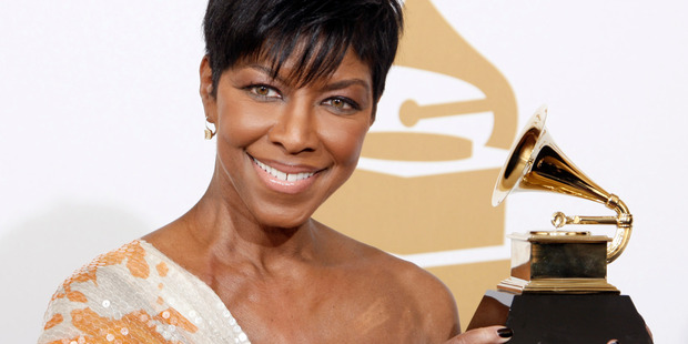 Natalie Cole holds the best instrumental arrangement accompanying vocalist award at the 51st Annual Grammy Awards in 2009. Photo / AP