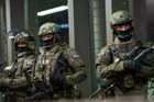 German special police protect the main train station in Munich after a terror attack warning. Photo / AP