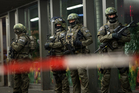 German special police stand in front of the Munich, southern Germany, main train station. Photo / AP