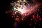 Fireworks explode off the Sky Tower, ushering in 2016 for Auckland. Photo / Dean Purcell