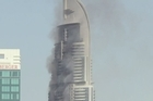 Smoke was still rising from a 63-storey luxury hotel in Dubai Friday as authorities worked to determine the cause of a spectacular fire that engulfed the building on New Year's Eve.