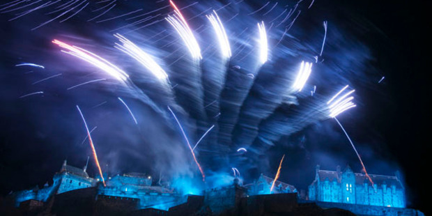 Fireworks light up the sky above Edinburgh castle as part of Hogmanay celebrations. Photo / Getty Images