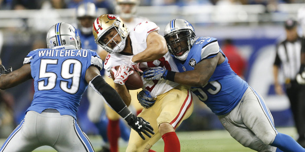 Jarryd Hayne gets hit during a clash against the Detroit Lions. Photo /Getty