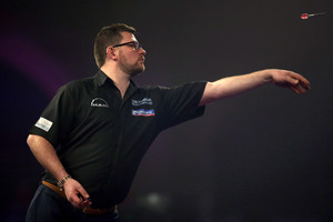 England's James Wade in action against Scotland's Gary Anderson. Photo / AP