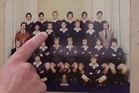 Auckland Grammar School headmaster Tim O'Connor points out Martin Crowe in the Graham Henry-coached 1980 1st XV rugby team (played 21, won 21). Photo / Jason Oxenham
