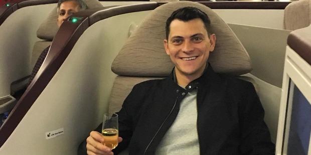 Matt Kepnes lives it up on Etihad Airways Business Class. Photo / nomadicmatt
