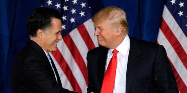 Mitt Romney and Donald Trump shake hands in 2012 as Trump endorses Romney's campaign. Photo / Getty Images